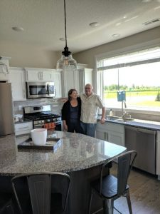 Chuck and Kelly enjoying their new kitchen.