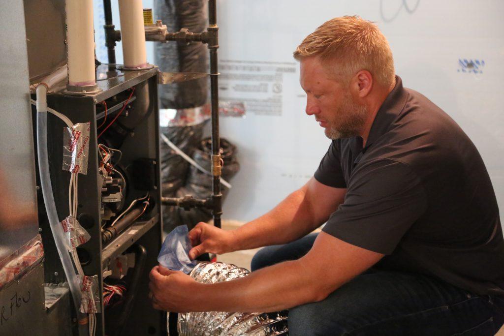 Man Testing Duct Work