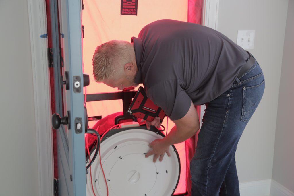 Man Testing Blower Door